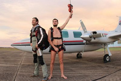 Man skydives naked while playing violin for 30th birthday