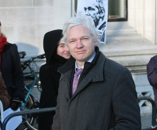 Prosecutors seek Julian Assange interview, DNA in London