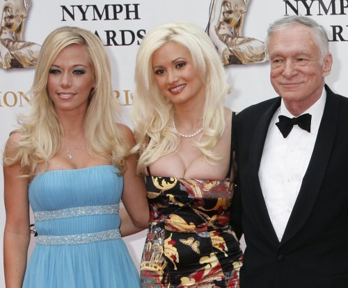 Kendra Wilkinson defends Hugh Hefner amid Holly Madison drama