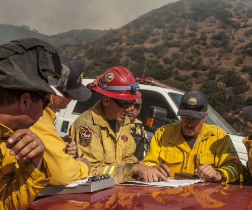 Crews struggle to contain Napa, Calif., wildfire that's burned homes, 70K acres