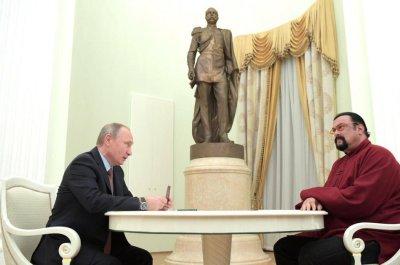 President Vladimir Putin presents Steven Seagal with Russian passport