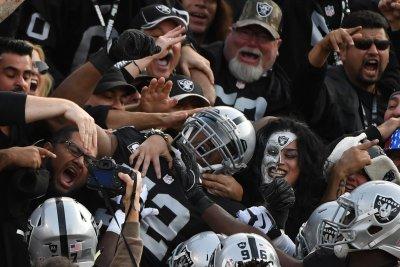 Derek Carr overcomes injury as Oakland Raiders edge Carolina Panthers