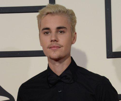 Justin Bieber dodges fan-flung water bottle after refusing to sing 'Despacito'
