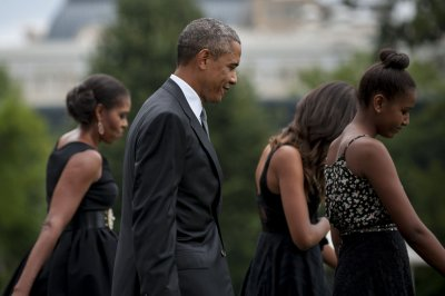 Obamas attend wedding of personal chef
