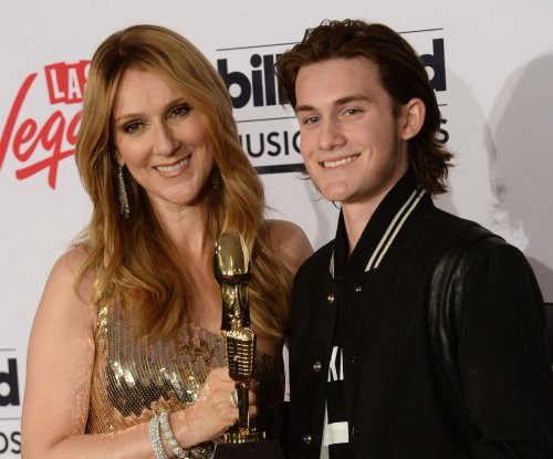 Celine Dion says sons are coping well with Rene Angelil's death