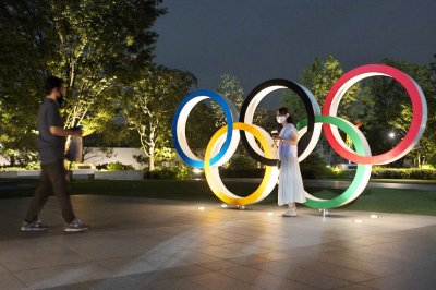 IOC, Tokyo officials say Olympics must go on in 2021 'at any cost'