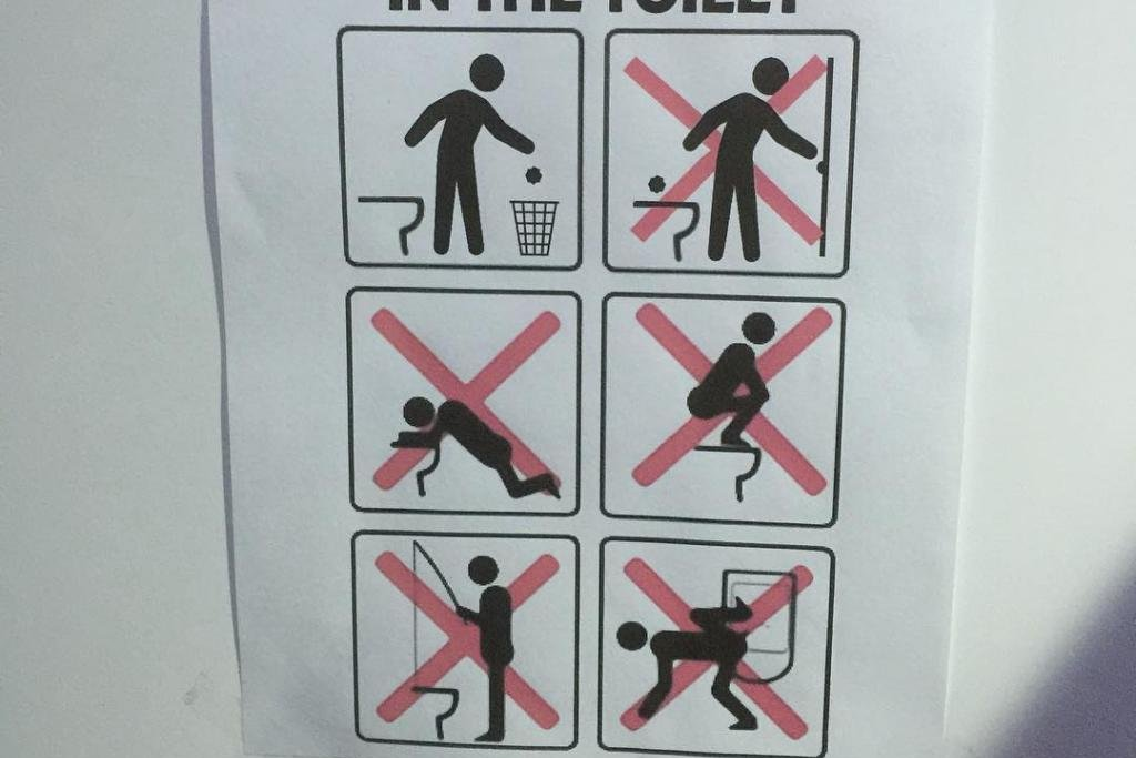 Bathroom Sign Texas Mall look: sign outside olympic village bathroom bans toilet fishing