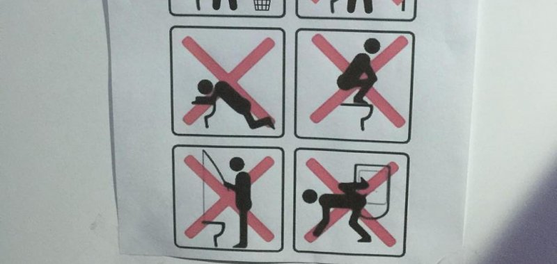 Bathroom Sign Game look: sign outside olympic village bathroom bans toilet fishing