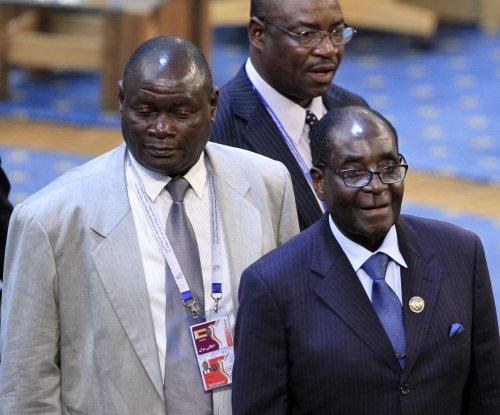 Zimbabwe's president kicks out private diamond miners, nationalizes industry