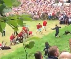 Dozens chase cheese wheel down steep hill in Britain