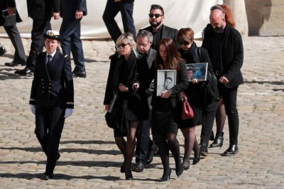 France honors soldiers who died during hostage rescue in Burkina Faso