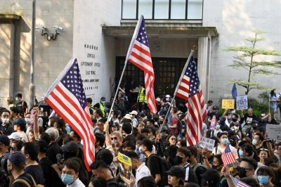 Hong Kong protesters march to U.S. Consulate in plea for help
