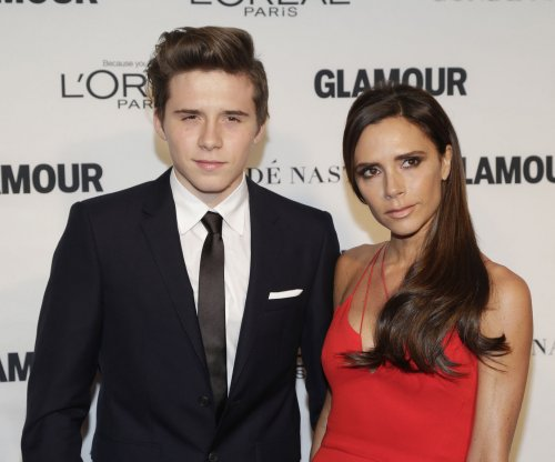 Victoria Beckham, son Brooklyn attend Glamour awards