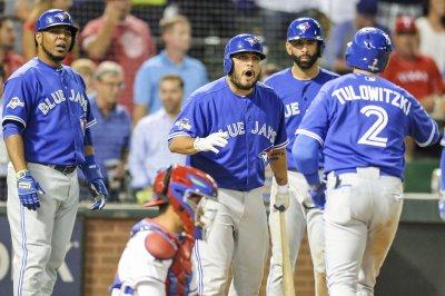 Troy Tulowitzki, Toronto Blue Jays blast Texas Rangers, stay alive