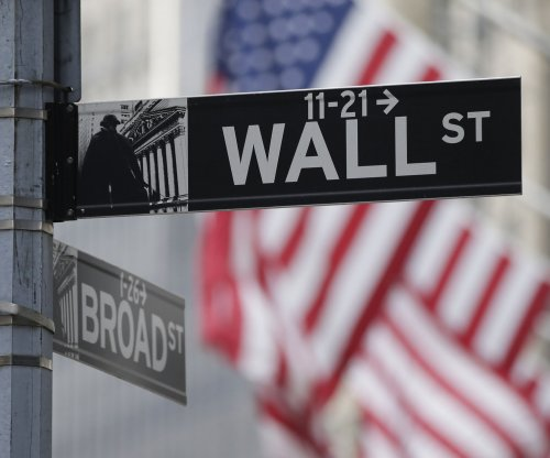 Dow rises above 26,000 for the first time