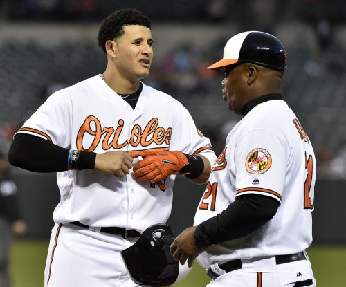 Manny Machado returns to help Baltimore Orioles keep Tampa Bay Rays down