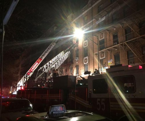 At least 12 dead in NYC apartment building fire
