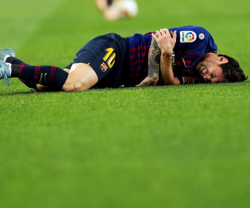 Lionel Messi breaks arm, out for three weeks