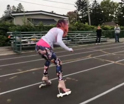 Woman in-line skates backward in heels for Guinness record