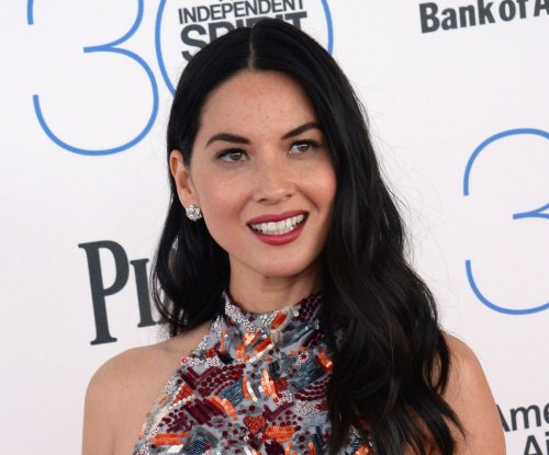Olivia Munn challenges Ryan Reynolds to an 'X-Men' sword fight