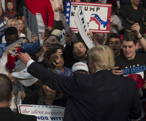 Michigan poised to boost front-runners Trump, Clinton