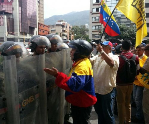 Venezuelan opposition protesters tear gassed, blocked by national guard