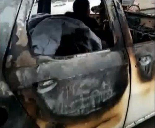Severely burnt-out car spotted driving on Chinese road
