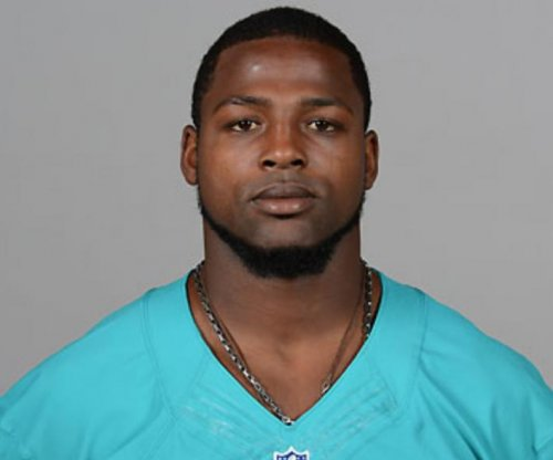 Miami Dolphins promote wide receiver Scott, defensive tackle Wright from practice squad