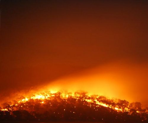 Firefighters battle tremendous wildfires in South Australia, Victoria