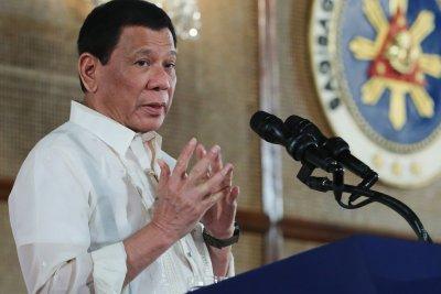 Filipinos march against President Rodrigo Duterte's drug war
