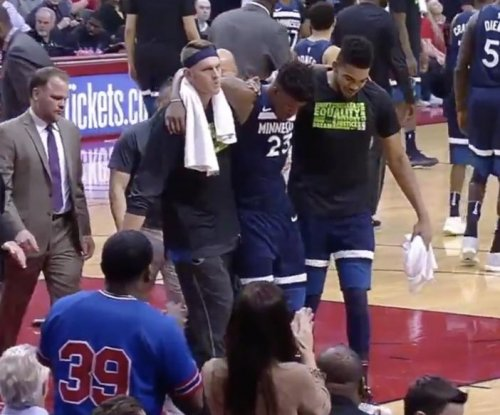 Minnesota Timberwolves' Butler carried off court after injury