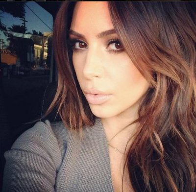 Kim Kardashian goes back to brown hair [PHOTO]
