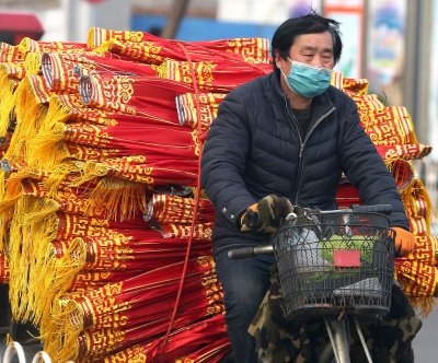 China reports nearly 900 new COVID-19 cases as spread declines