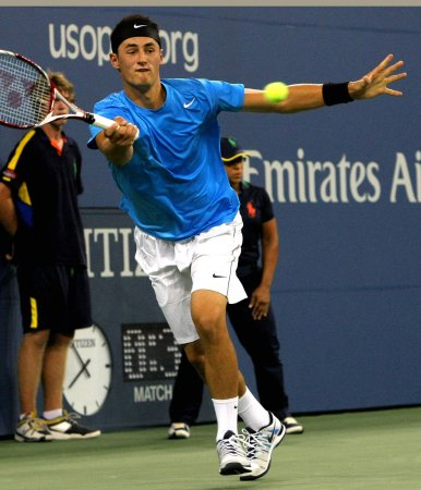 Tomic wins first ATP title