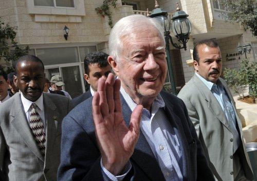 Former President Carter arrives in Syria