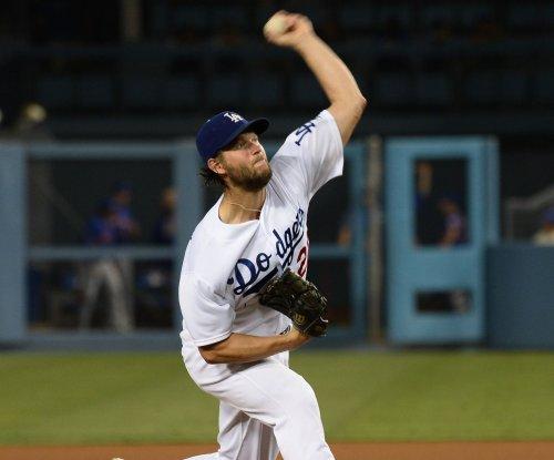 Clayton Kershaw, Yasmani Grandal lead Los Angeles Dodgers past San Francisco Giants