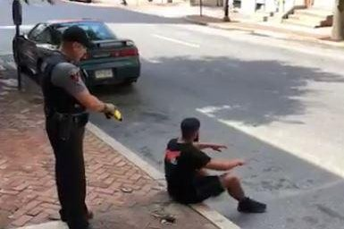 Video shows Pennsylvania cop Tase man sitting on curb