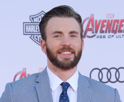 Watch Chris Evans play coy about Lily Collins dating rumors