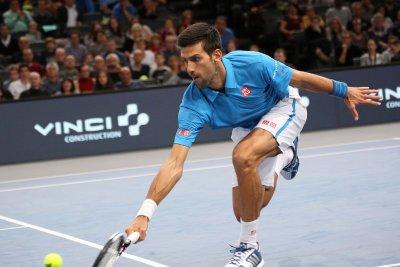 Novak Djokovic overcomes first-set loss for win in London