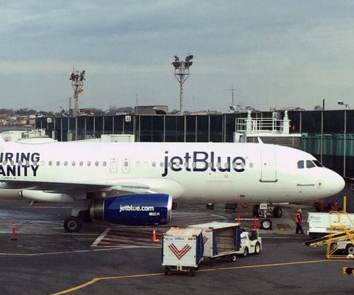 Van collides with JetBlue plane on tarmac in Boston
