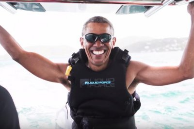 Barack Obama learns how to kitesurf with Richard Branson during vacation