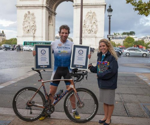 British cyclist bikes around the world in record 78 days