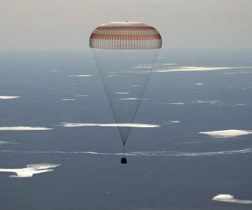 Space station crew members return to Earth