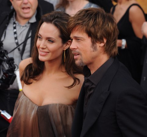 Brad, Angelina top plastic surgery poll