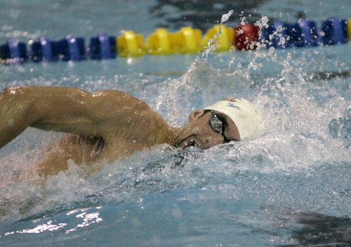 Phelps sets world record in butterfly