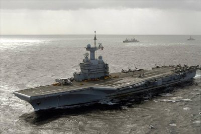 France sending artillery, aircraft carrier to Iraq to fight Islamic State