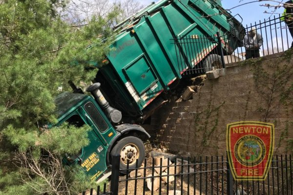 Look: Garbage truck dangles over retaining wall - UPI.com