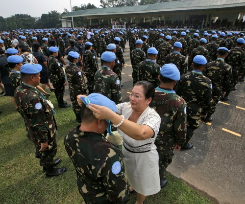U.N. flag, blue helmet don't offer 'natural' protection to peacekeepers, report says