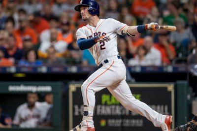 Astros visit Red Sox for matchup of division leaders