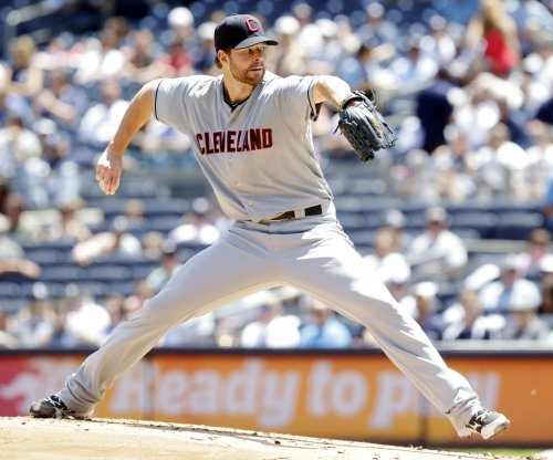 Cleveland Indians give Corey Kluber plenty of help in 12-1 blowout